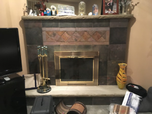 High end glass, polished brass fireplace door w/ matching tools