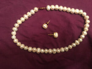 3 piece 14K gold south sea pearl necklace and earrings.