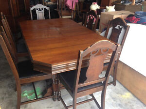 Century old walnut table and 6 chairs