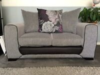 Beautiful condition two seater grey sofa