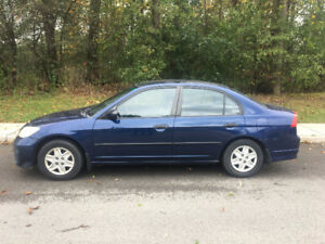 2005 Honda Civic Sedan with Winter tires + Rims
