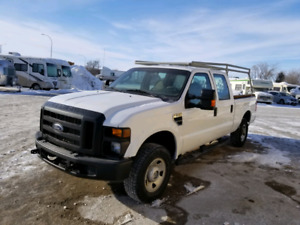 2009 F250 crew cab, 4x4, ladder rack