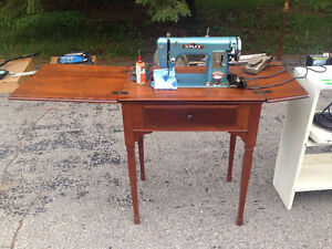 Sewing machine in working condition with wooden cabinet