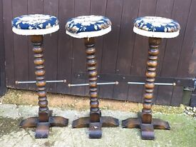 Three wooden carved Ercol bar kitchen stools