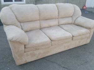 BEIGE MICROFIBER COUCH.  DELIVERY IS EXTRA