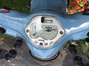 2009 baby blue LX150 vespa