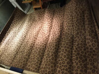 Reduced. 2 cheetah print carpets area rug