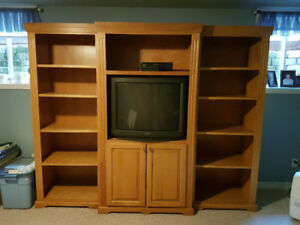 Solid maple media unit. 100 inches long, 78 tall and 20 deep.