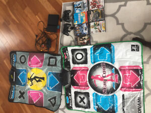 PlayStation2 with remotes, Dance dance revolution mats & 7 games