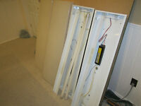 2 Fluorescent light fixtures with white covers 1ft x 4ft