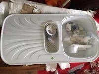 White kitchen sink with tap.