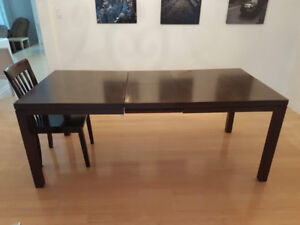 Wooden EQ3 dining room table and chairs.  Very good condition.
