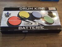 NEW CONDITION GUITAR AND DRUM KIT;  $45 FOR BOTH