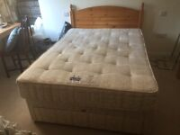 Double bed with mattress and front drawers and pine headboard. Can deliver.