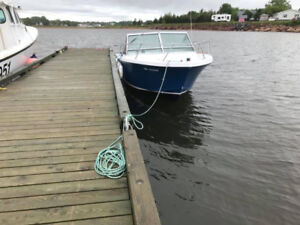 24ft Limestone boat, 350 Chev, Cox Super Loader Trailer,