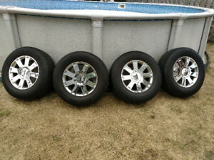 Four 18 inch summer tires and mags