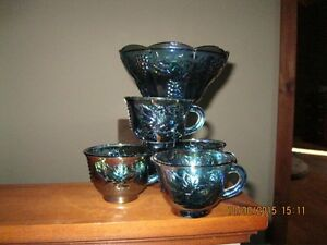 Carnival glass bowl and 4 cups