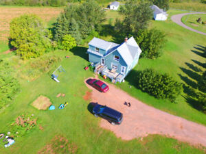 4 B/R home, PEI. includes 25 acres of land.