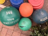 Various medicine balls, kettle bells and sand bags