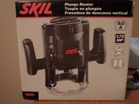 New Skil plunge router