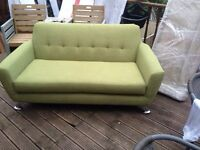 Exdisplay moss green two seater sofa.