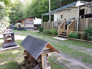 Trailer on lot with Storage Shed