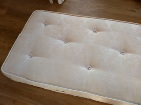 Single mattress. White. We'll padded and constructed.