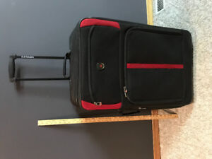 Large Suitcase in good condition! Wheels and adjustable handle!