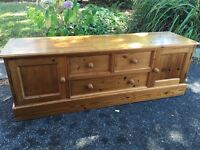 Large solid pine tv unit/sideboard with possible delivery