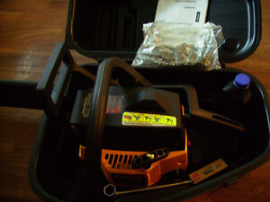 Brand New Poulan Pro Professional Chain Saw still in the case