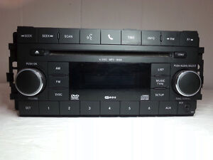 2009-10 Dodge Journey Radio AM/FM Mp3 Aux DVD 6 CD Changer OEM