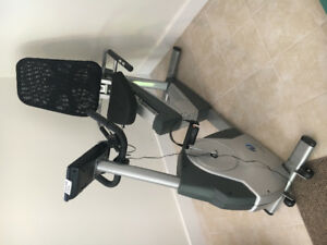 Exercise bike and various gym equipment