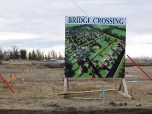 New Subdivision in Raymond, AB - Bridge Crossing