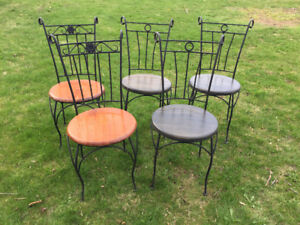 Antique bed frames and cafe chairs
