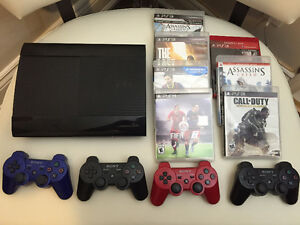 PlayStation 3 with 4 Controllers and 7 Games