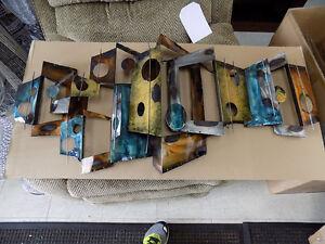 "Metal Art 42"" x 19"" $ 125.00  Call 727-5344"