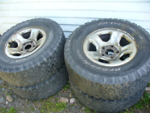 "4- Dodge 17""X 9""  Rims + 285  70 R 17  Tires great for off road"
