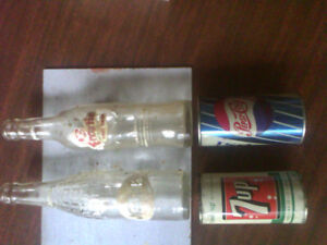 Pop bottles and steel can,s