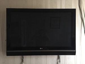 "42""LG Tv with wall stand"