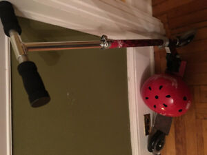 Selling a gently used scooter and red helmet.