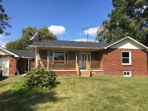 NEWLY RENOVATED COUNTRY HOME WITH 1.3 ACRE LOT