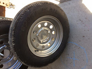 "FOR SALE – 12"" STANDARD TRAILER TIRE ON CHROME RIM."