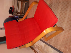 Red Ikea Poäng Arm Chair with foot rest