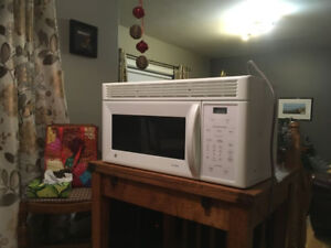 GE over the range microwave oven with built in exhaust fan