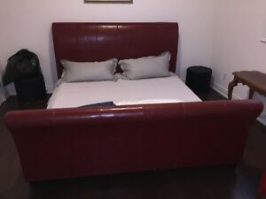 KING SIZE BED RED LEATHER WITH NEW BOX SPRING MUST SELL