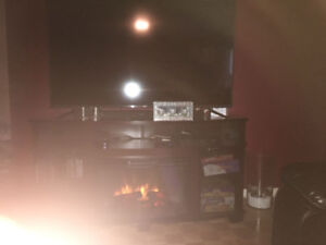 "Electric Fireplace. 57"" LG Plasma TV and Dresser"