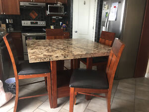 Solid granite and wood table and chairs