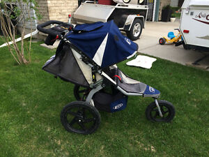 Navy BOB Stroller with LOTS of accessories