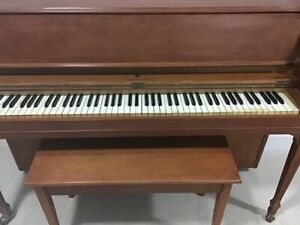 40 inch upright Gerhard Piano. Great for kids learning to play.
