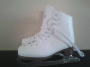 2 pairs of girls  ice skates